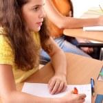 School girl sitting in classroom — Stock Photo #63458677