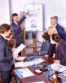 Business people with chart in office — Stock Photo