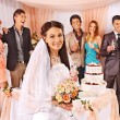 Bride and guests with cake — Stock Photo #63467815
