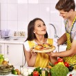 Young family cooking pizza at kitchen. — Stock Photo #66715529
