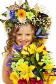 Little girl with flowers hairstyle. — Stock Photo