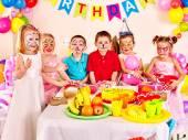 Children happy birthday party eating. — Stock Photo