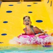 Child on water slide at aquapark. — Stock Photo #67895347