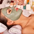 Clay facial mask on woman — Stock Photo #69905311