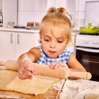 Child with rolling-pin dough — Stock Photo #70762517
