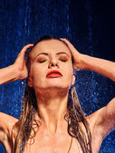 Woman under water shower. — Stock Photo