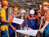 People in builder helmets . — Stock Photo