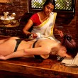 Woman having massage with pouch of rice. — Stock Photo #71705775