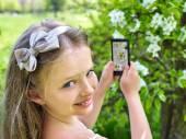 Girl snapshot blossoming tree. — Stock Photo