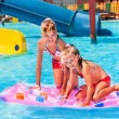Child on water slide at aquapark. — Stock Photo #71724329