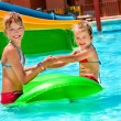Children sitting on inflatable ring. — Stock Photo #71724389