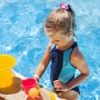 Child with bucket in swimming pool. — Stock Photo #71724415