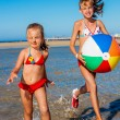 Children  running on  beach. — Stock Photo #71724483
