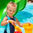 Child with bucket in swimming pool. — Stock Photo #71724499