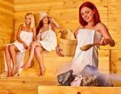 Friends relaxing in sauna. — Stock Photo