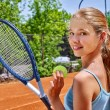 Постер, плакат: Girl with racket and ball on tennis court