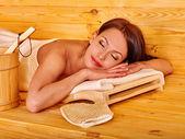 Girl sleeping in sauna. — Stock Photo