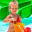 Child with bucket in swimming pool. — Stock Photo #73846779