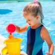 Child with bucket in swimming pool. — Stock Photo #73846799
