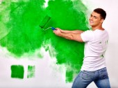 Man paint wall at home. — Stock Photo
