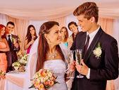 Wedding couple drinking champagne — Stock Photo