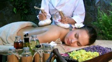 Woman getting thai herbal massage — Stock Video