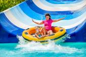 Child with mother on water slide — Stock Photo