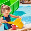 Child with bucket in swimming pool. — Stock Photo #75129259
