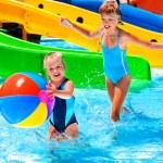 Children near water slide at aquapark. — Stock Photo #75129411
