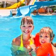 Kids with armbands in swimming pool. — Stock Photo #75129425