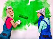 Women paint wall at home. — Stock Photo