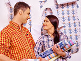 Family glues wallpapers at home. — Stock Photo