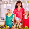 Mother with daughters and son cooking — Stock Photo #75148307