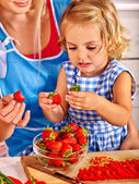 Mother feed child at kitchen. — Stock Photo