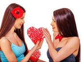 Sexy lesbian women taking heart — Stock Photo