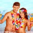 Couple with cocktail at Hawaii wreath beach. — Stock Photo #75154205
