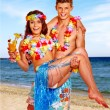 Couple with cocktail at Hawaii wreath beach. — Stock Photo #75154251