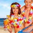 Couple with cocktail at Hawaii wreath beach. — Stock Photo #75154297