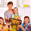 Happy family with grandmother at kitchen. — Stock Photo #76107477