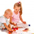 Children painting by fingers — Stock Photo #76108251