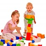 Children play building blocks. — Stock Photo #76108267