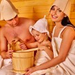 Group people in hat  at sauna. — Stock Photo #76108347