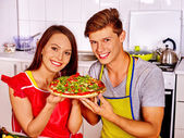 Young family cooking pizza at kitchen. — Stock Photo