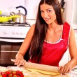 Young woman cooks at kitchen. — Stock Photo #78142564