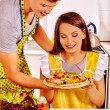 Young family cooks pizza at kitchen. — Stock Photo #78142728