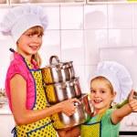 Girls holding casseroles — Stock Photo #78757590