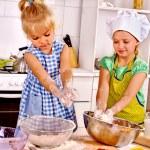 Girls preparing dough — Stock Photo #78757596