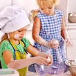 Girls preparing dough — Stock Photo #78757600