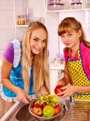 Mother and daughter with fruits — Stock Photo