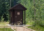Wooden restroom in forest — Stock fotografie